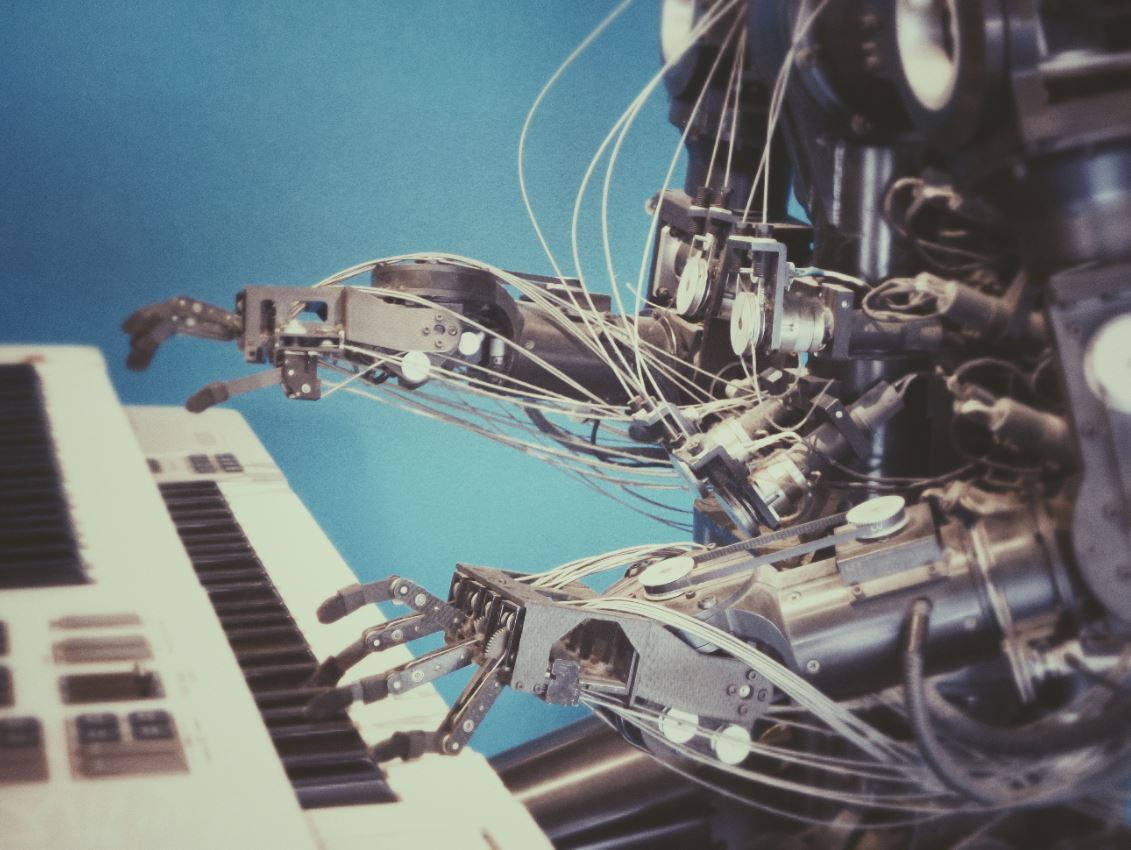 A robot sitting playing piano